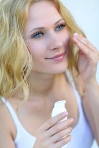 Woman Applies Best Sunscreen for Her Skin